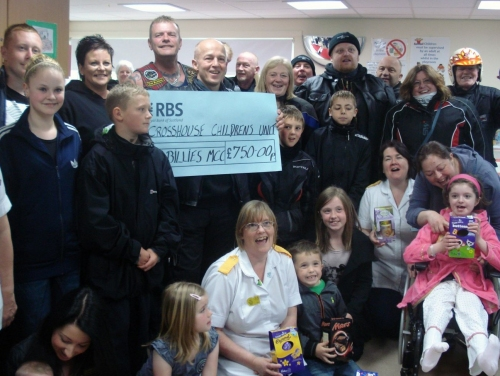 Handing over easter eggs and a cheque to the kids and staff at the Children's Unit. (2010)